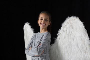Portrait smiling, confident girl wearing angel wings