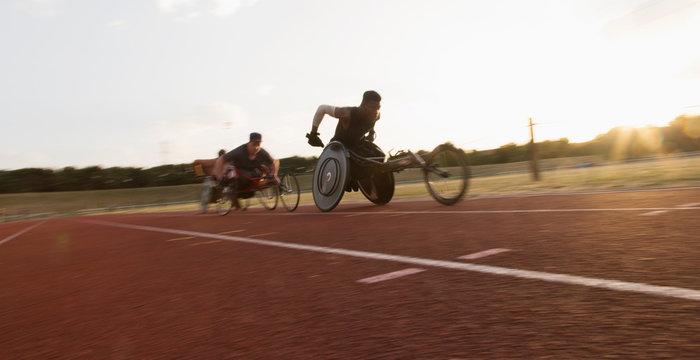 Paraplegic athletes speeding along sports track during wheelchair race
