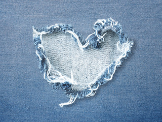 Heart shape ripped jean denim texture