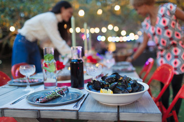 Mussels on dinner garden party table
