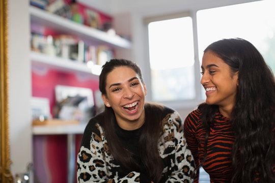 Portrait laughing teenage girl friends