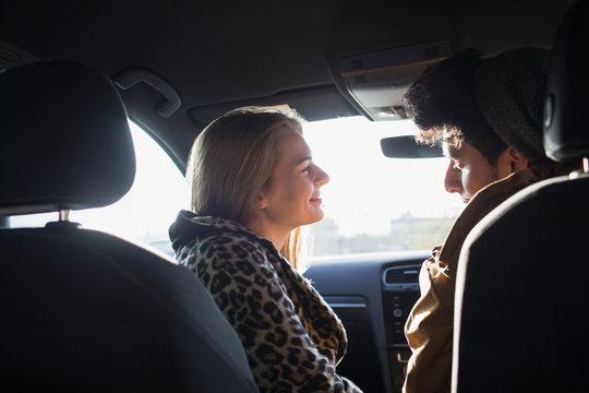 Young couple talking in car