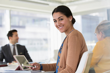 Portrait confident businesswoman in conference room meeting