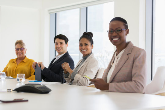 Portrait smiling, confident business people in conference room meeting