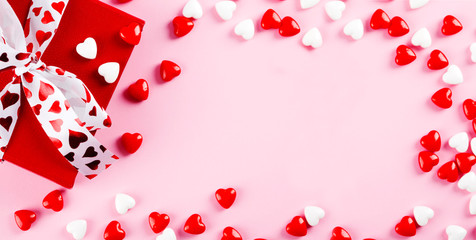 "Valentine""s day background. Red gift box and candy on pink background. Valentines day concept."