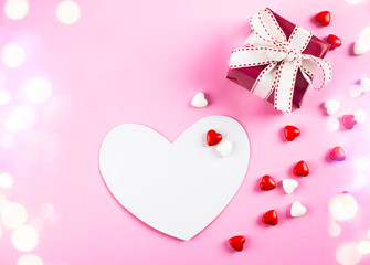 "Valentine""s day background. Red gift box, card and candy on pink background. Valentines day concept."