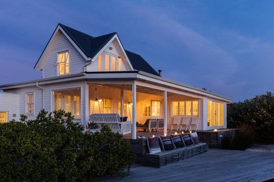 Illuminated white home showcase exterior at night