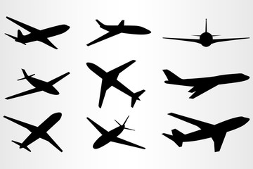 Set of nine stylized silhouettes of flying planes. Set for travel needs.