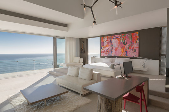 Modern, luxury home showcase bedroom with sunny ocean view