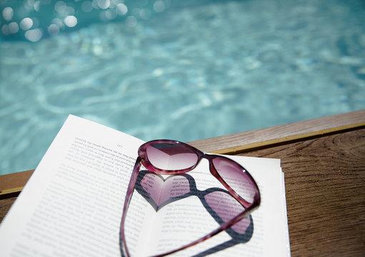 Heart-shape sunglasses at poolside