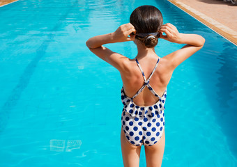 Girl at sunny poolside