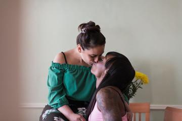 Affectionate lesbian couple kissing
