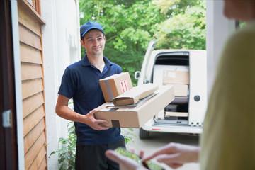 Smiling deliveryman at front door