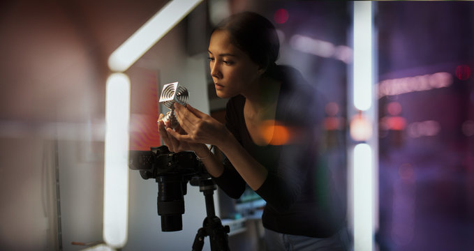Female photographer looking at prototype