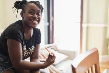Portrait smiling, confident tween girl eating pizza