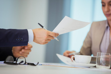Business people with paperwork in meeting