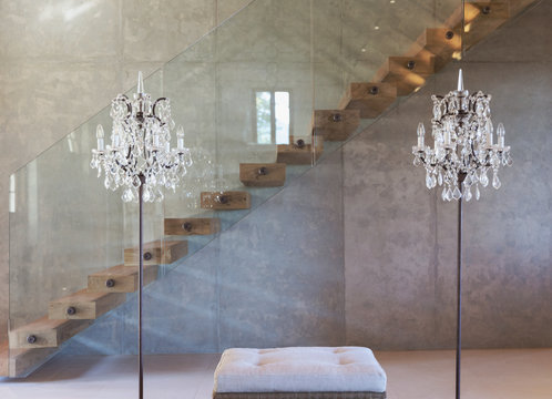 Home showcase interior chandelier lamps in front of modern floating staircase