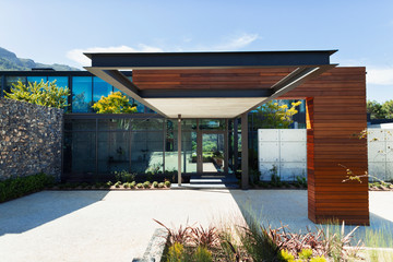 Sunny, modern luxury home showcase exterior