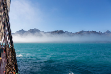 Scenic view fog clearing over mountain range Greenland