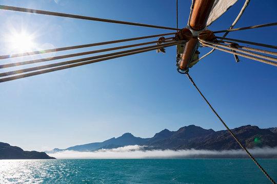 Sailboat mast over sunny remote Atlantic Ocean Greenland