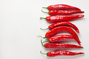 Canvas Prints Hot chili peppers Red chilli peppers on white wooden table. Hot spicy food ingredient