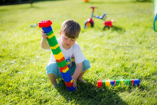 Boy playing with plastic bricks