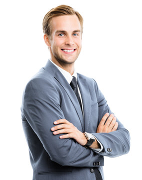 Portrait picture of happy smiling businessman in grey confident suit, crossed hands, isolated on white background. Business success concept.