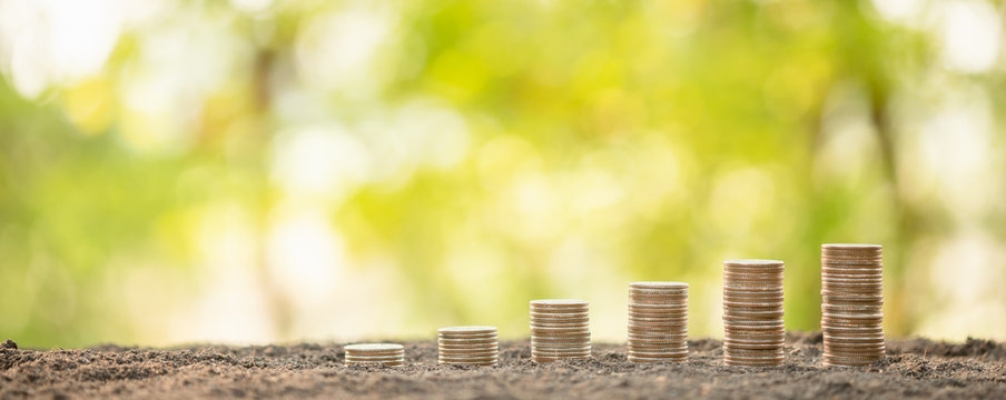 Coin stack on blur background. Business success or money growing concept