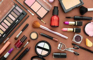 Make up cosmetics products against brown color background