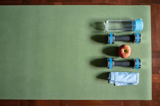Gym equipment on yoga mat