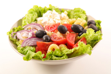 Fotobehang - mixed vegetable salad with tomato, olive, onio, feta cheese and pasta