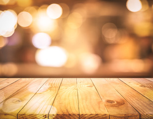 Wood texture table top (counter bar) with blur light gold bokeh background