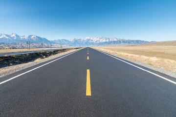 empty asphalt road to distant landscape