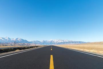asphalt highway on wilderness