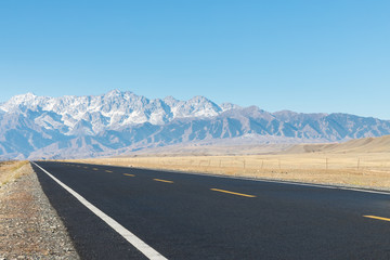 empty asphalt road on wilderness