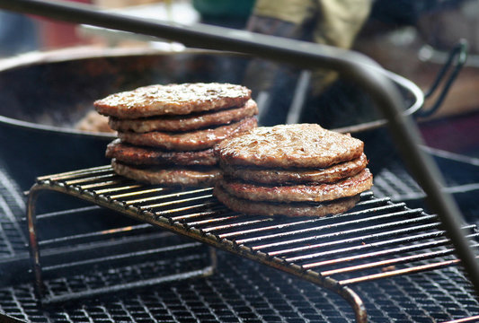 Juicy Stack of Burgers on the grill waiting to raise your cholesterol