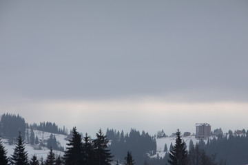 Poster Morning with fog landscape view of snowed winter mountains