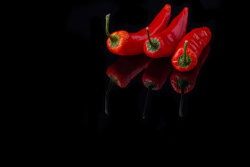 Canvas Prints Hot chili peppers Red chili peppers on black background. Three hot chili peppers and copy space. Spices concept.
