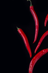 Canvas Prints Hot chili peppers Red hot chili peppers and copy space. Ripe spicy chili peppers on black background. Asian cuisine food.