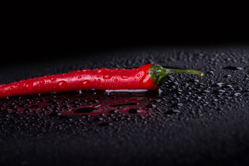 Canvas Prints Hot chili peppers Slim red chili in details. Pepper in the darkness. Food concept.
