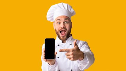 Excited Chef Man Showing Smartphone Screen Posing, Studio Shot, Panorama