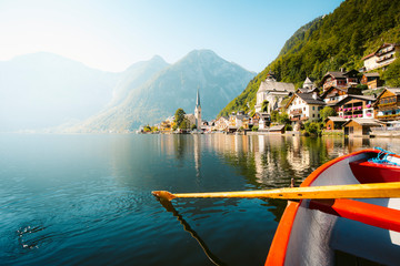 Wall Mural - Classic view of Hallstatt with traditional rowing boat in summer, Salzkammergut region, Austria