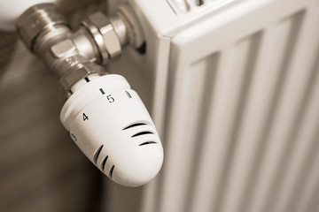 Photo of a heating radiator with temperature regulator