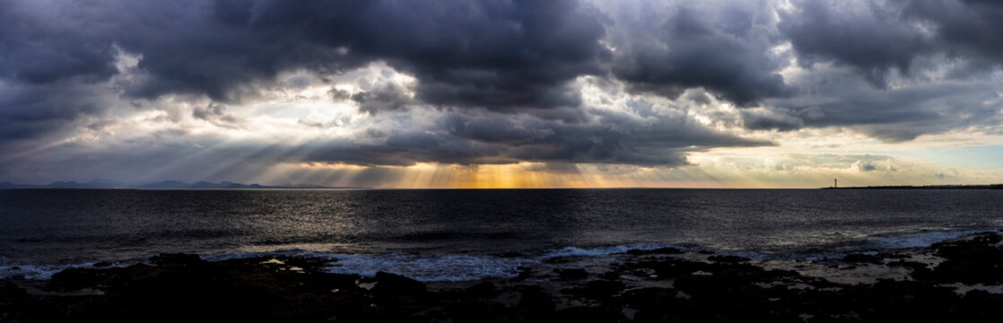 Inspirational Light, coming through the clouds. Showing us there is still hope, there always is. Awesome view of clouds over sea, with rays of sunlight bursting from the clouds.