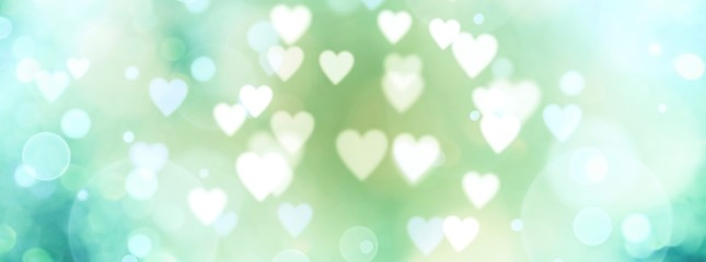 Abstract pastel background with hearts - blurred bokeh lights
