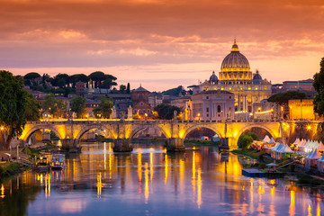Wall Mural - Night view of old Sant' Angelo Bridge  and St. Peter's cathedral in Vatican City Rome Italy.