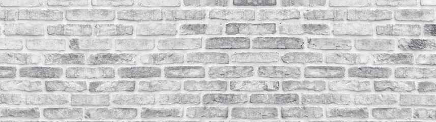 White washed shabby brick wall wide texture. Large light gray rustic brickwork wallpaper....