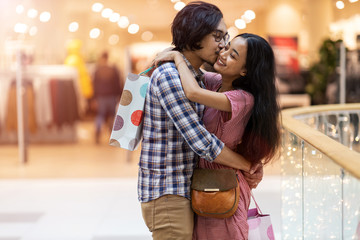 Happy young couple in shopping mall
