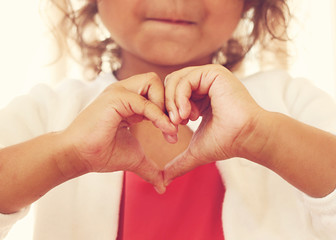 Girl making a heart shape with her hands