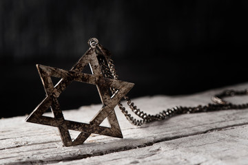 the star of david on a rustic wooden surface
